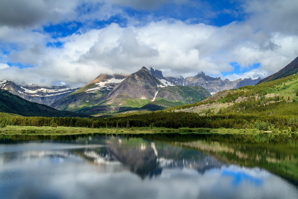 Mount Wilbur and Swiftcurrent Mountain shrouded in clouds